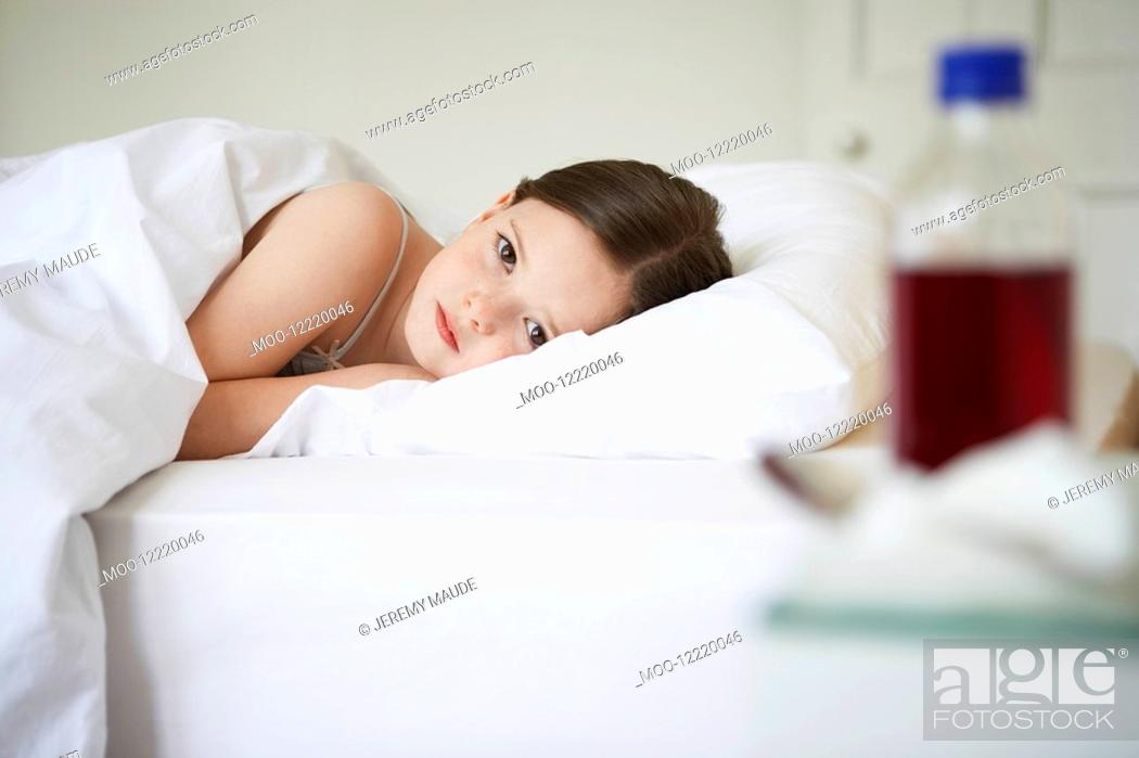 Stock Photo: Little Girl in Bed with a Cold portrait.