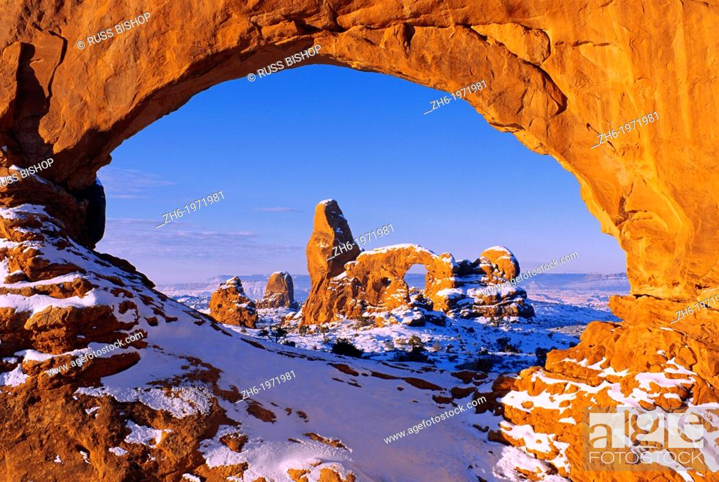Stock Photo: Morning light on North Window framing Turret Arch in winter, Arches National Park, Utah USA.