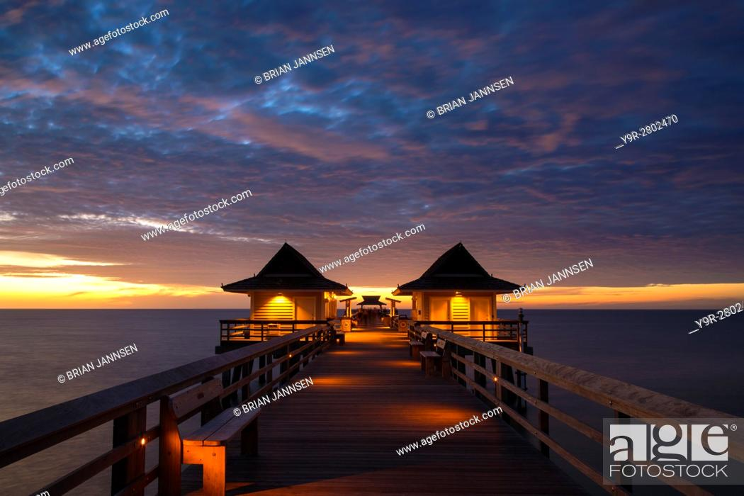 Stock Photo: Dusk over the pier and Gulf of Mexico from Naples, Florida, USA.