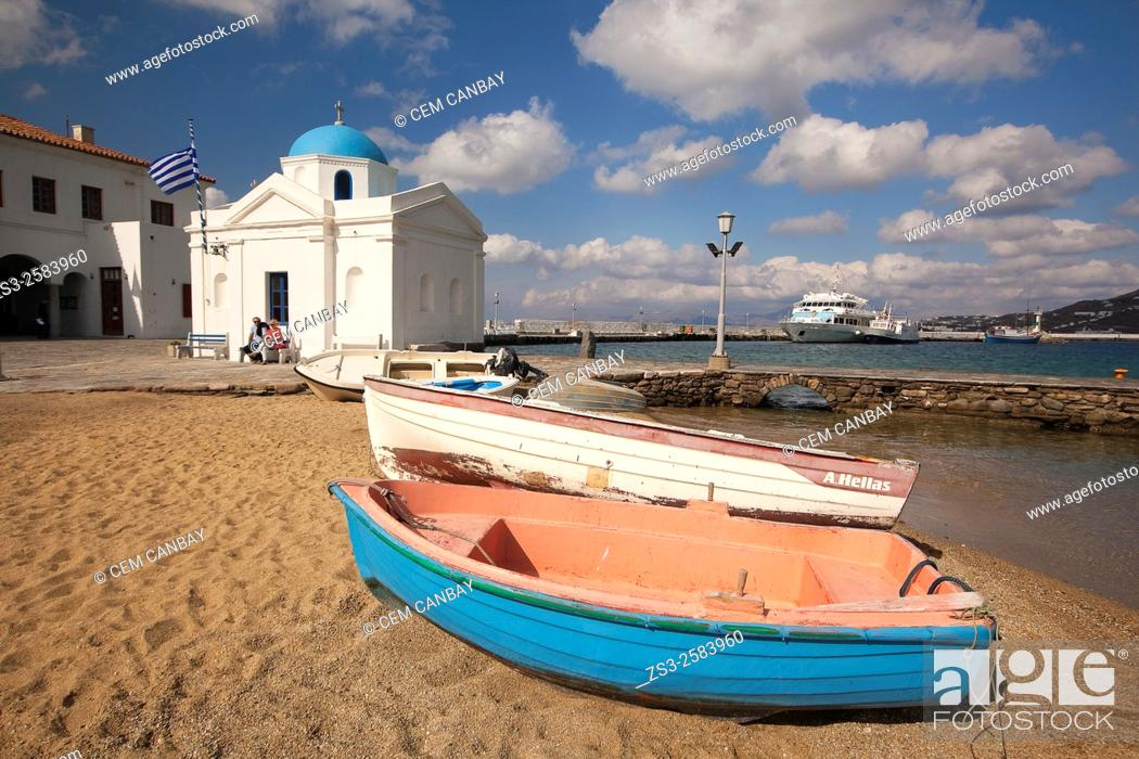 Stock Photo: Colorful fishing boats and a blue domed church by the sea, Mykonos, Cyclades Islands, Greek Islands, Greece, Europe.