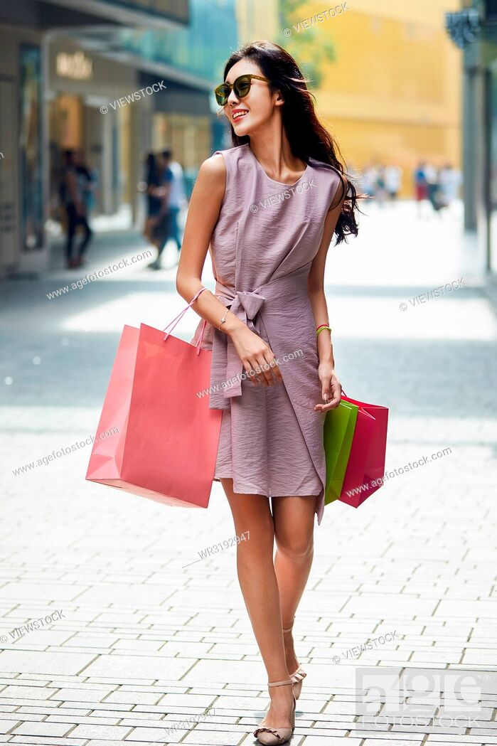 Stock Photo: Young women go shopping.