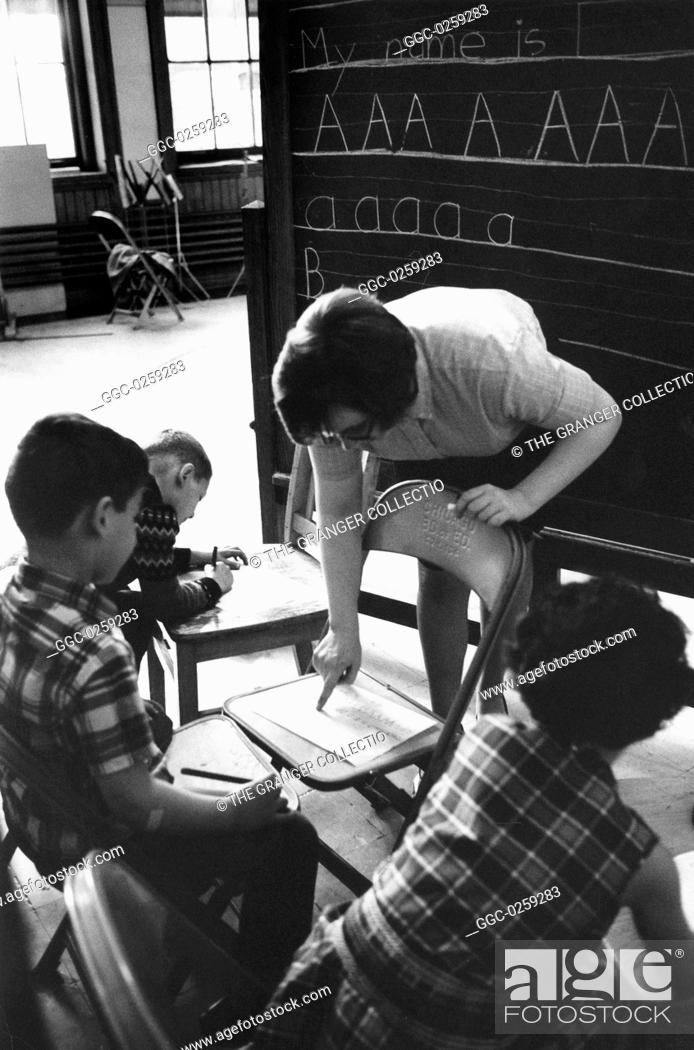Stock Photo: First graders being taught by a VISTA volunteer in Chicago, Illinois. Photograph, c1970.