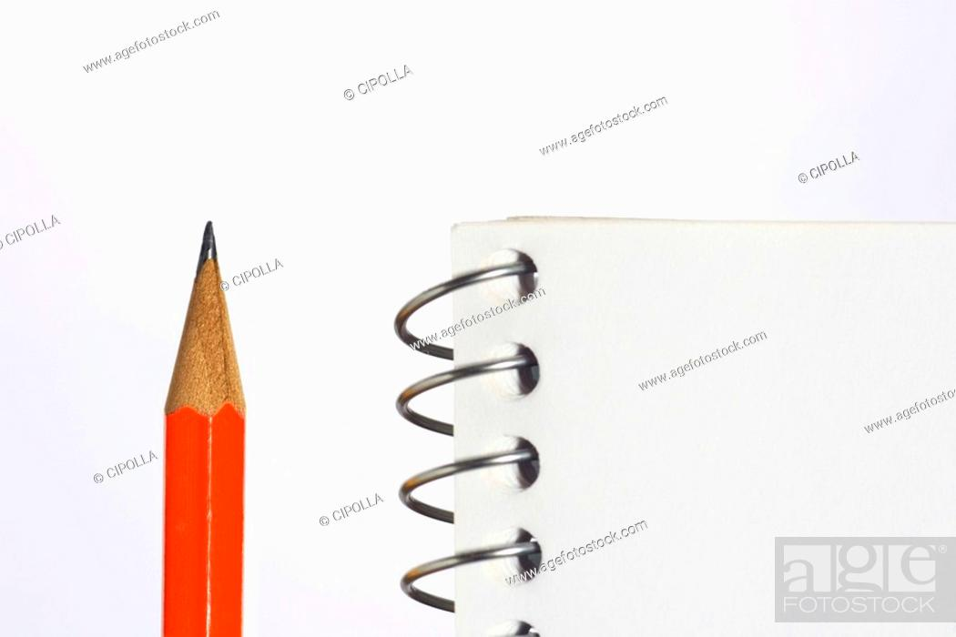 Stock Photo: Spiral notebook and pencil, detail.