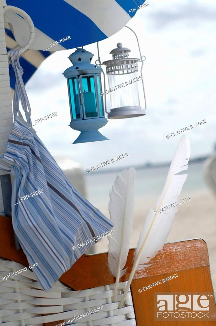 Stock Photo: Beach chair with feathers and lanterns.