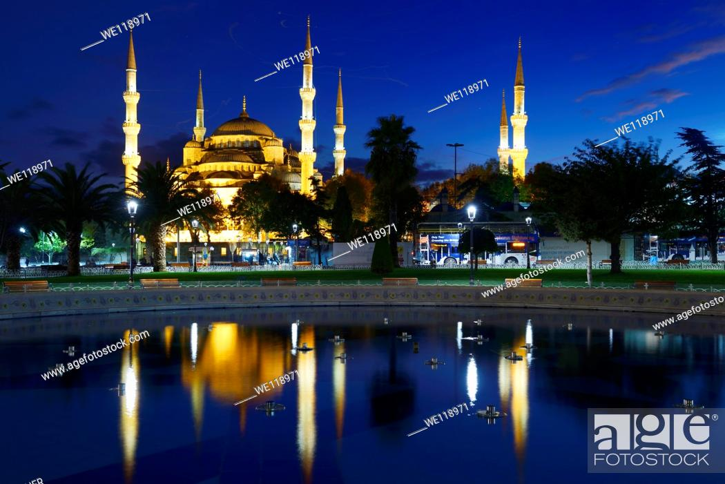 Stock Photo: Blue Mosque lit at dusk with reflection in fountain Istanbul Turkey.