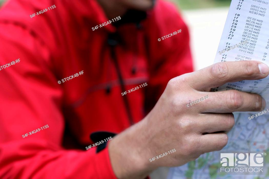 Stock Photo: Mountaineer reading a map.