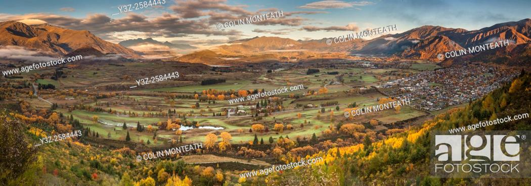Stock Photo: Dawn panorama of Arrowtown, (far right), autumn in Otago.