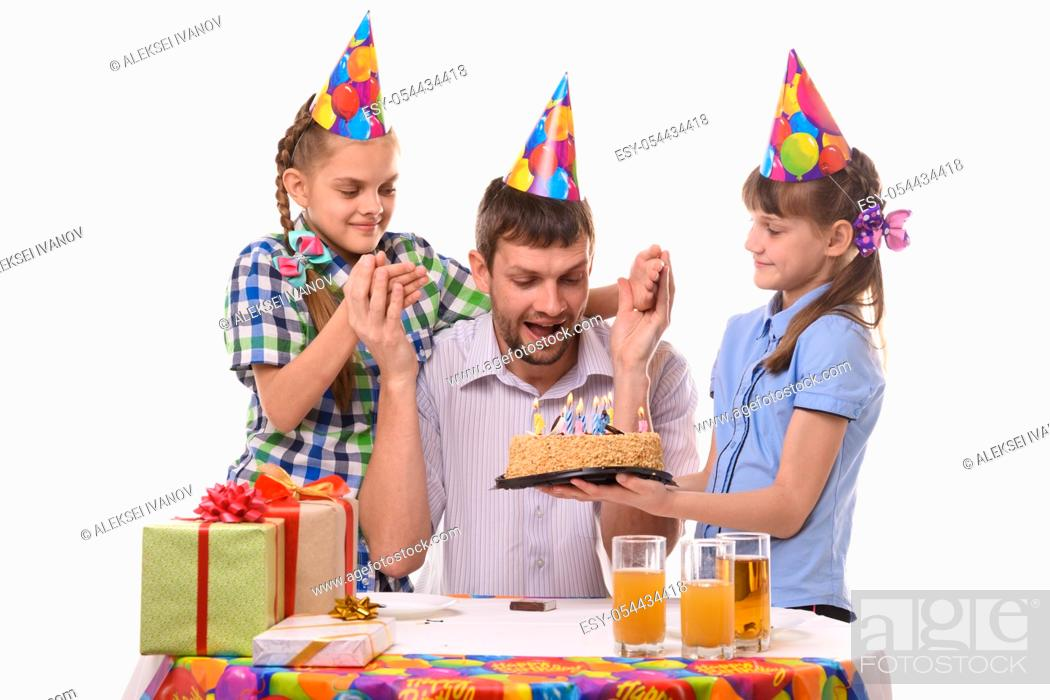Stock Photo: Dad is very happy about the festive sweet surprise prepared by the children.