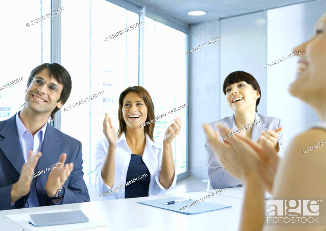 Stock Photo: Business team clapping in meeting.