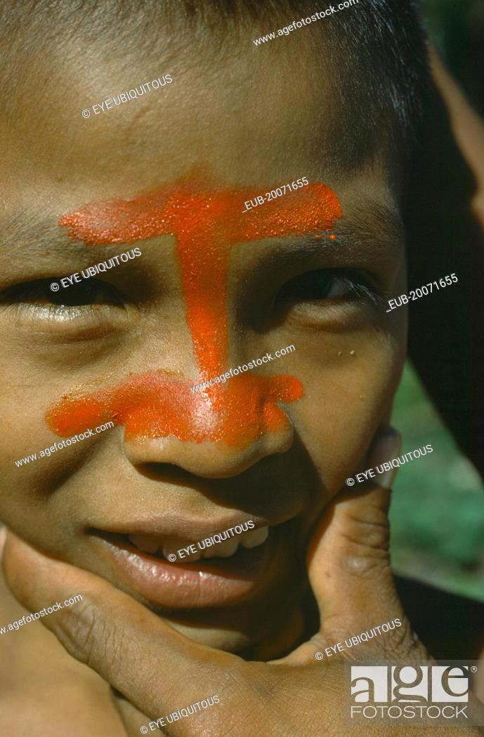 Portrait Of Auca Indian With Red Achote Paint Decorating Face Stock