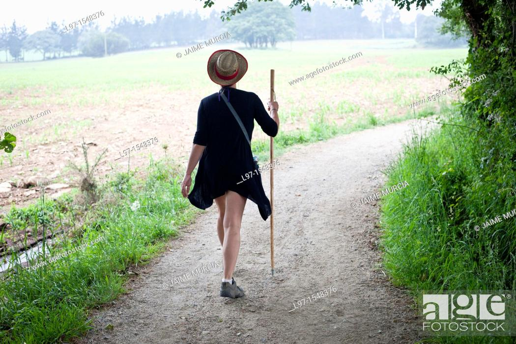 Stock Photo: A women walking the Camino de Santiago near the village of Casanova.