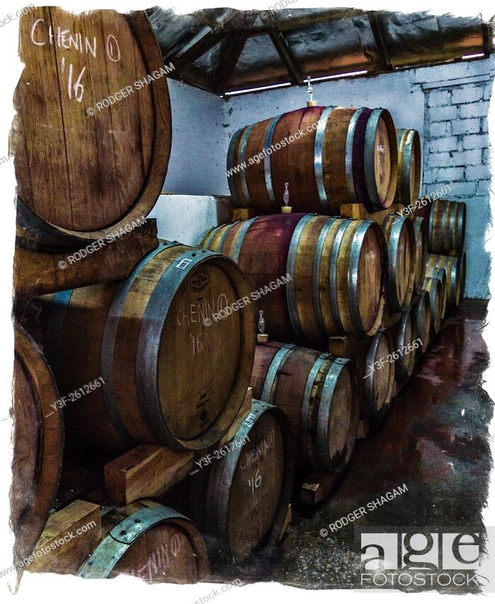 Stock Photo: Wine maturing in barrels in a wine cellar. Grunge with border. Western Cape Province, South Africa.