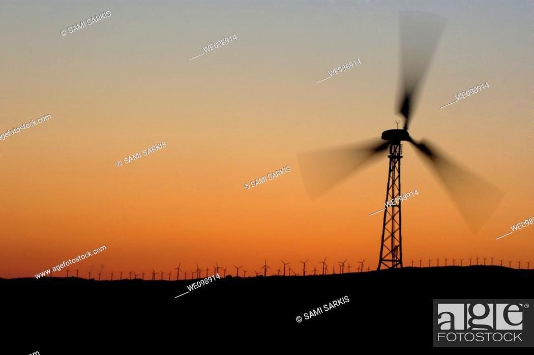 Stock Photo: Wind turbine on a ridge at sunset, Tarifa, Andalusia, Spain.