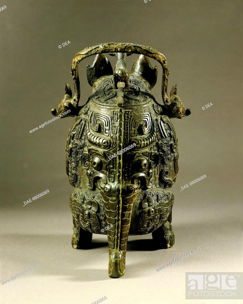 Stock Photo: CHINESE ART XI-XVI CENTURY BC SHANG DYNASTY BRONZE VASE THAT BEHIND THE TIGER VISA  Paris, Musée Cernuschi (Oriental Art Museum).