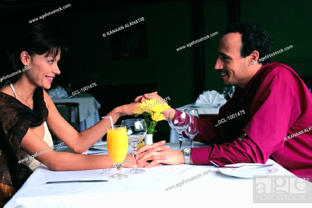 Stock Photo: Amorous couple in a restaurant.