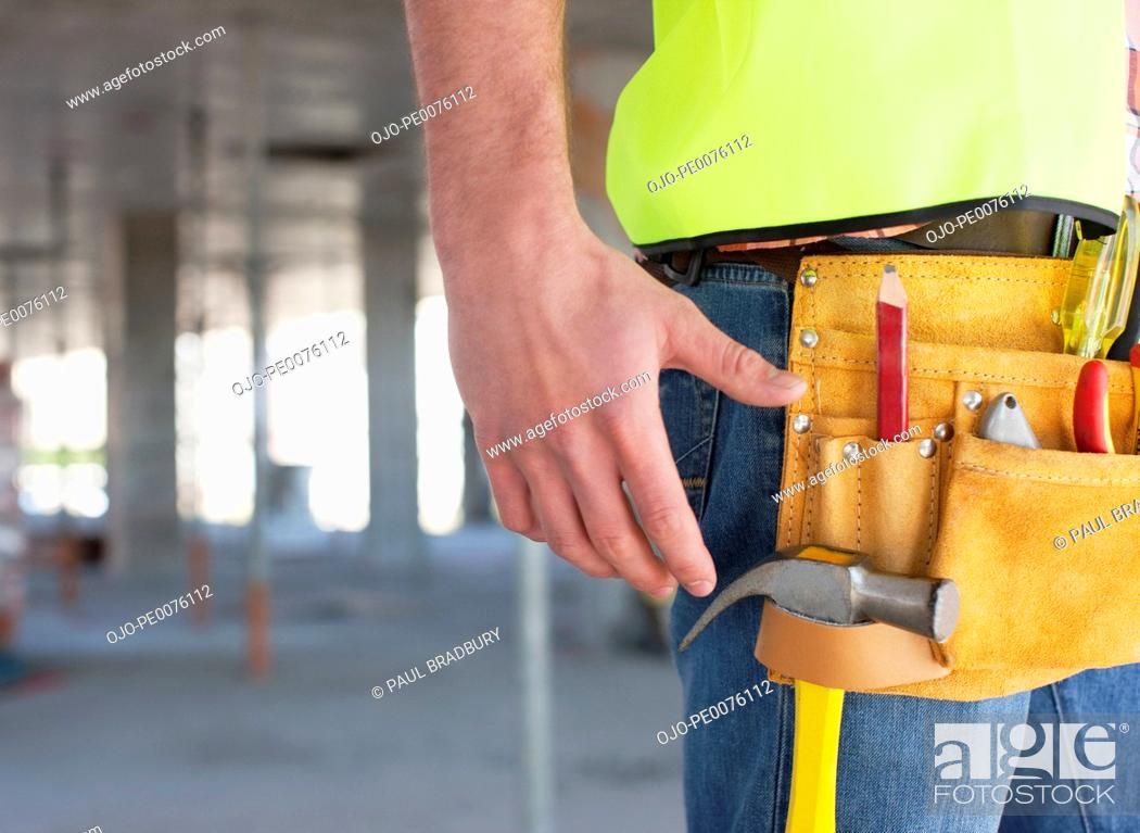 Stock Photo: Close up of construction worker's tool belt on construction site.