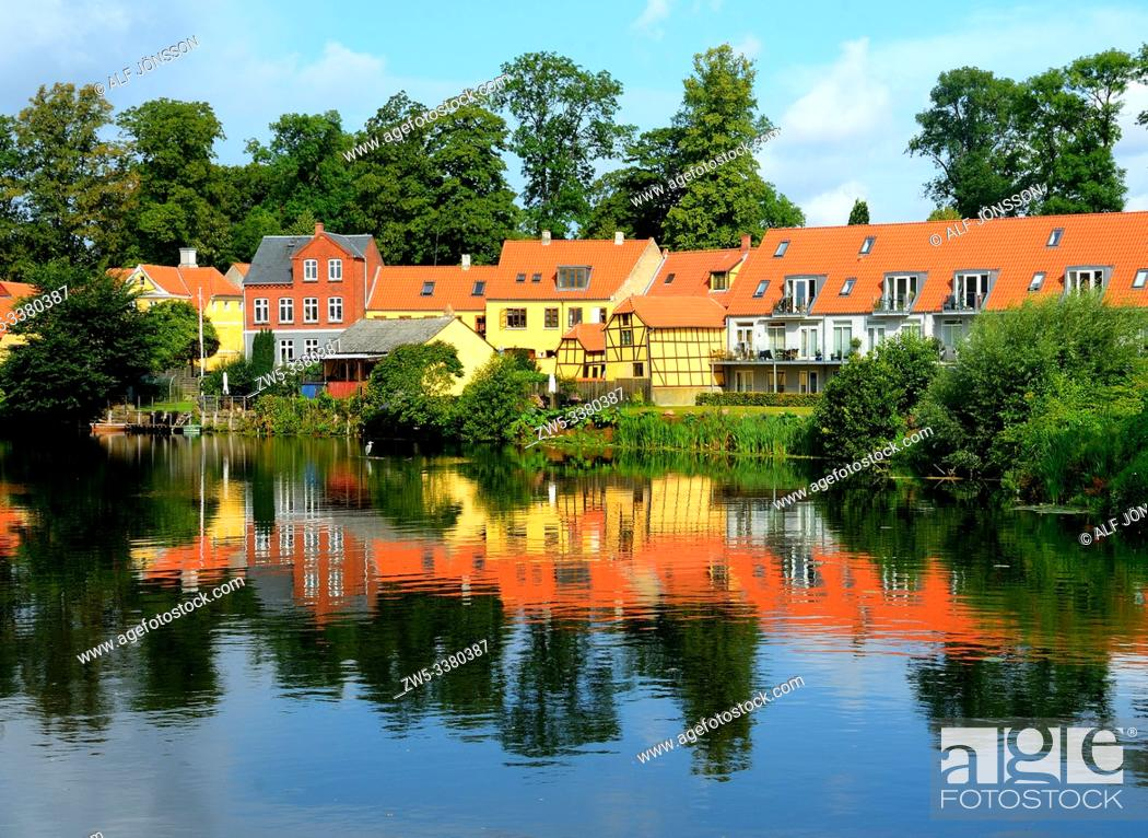 Stock Photo: Old houses mirroring in water surface in Nyborg, Fyn, Denmark.