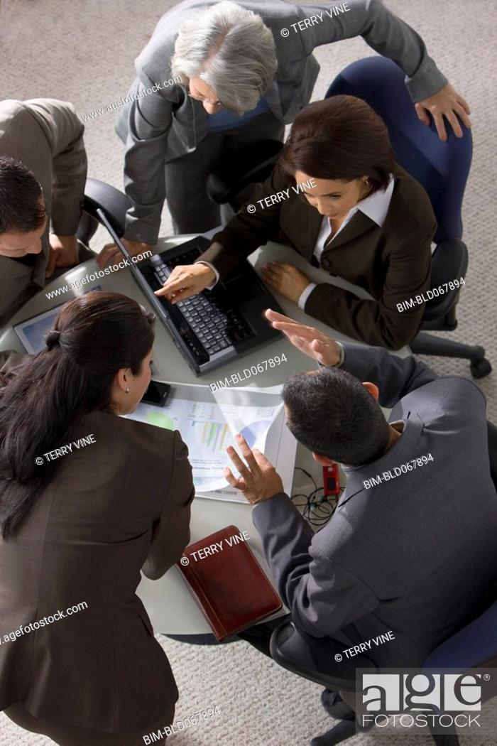 Stock Photo: Overhead view of business people having meeting.