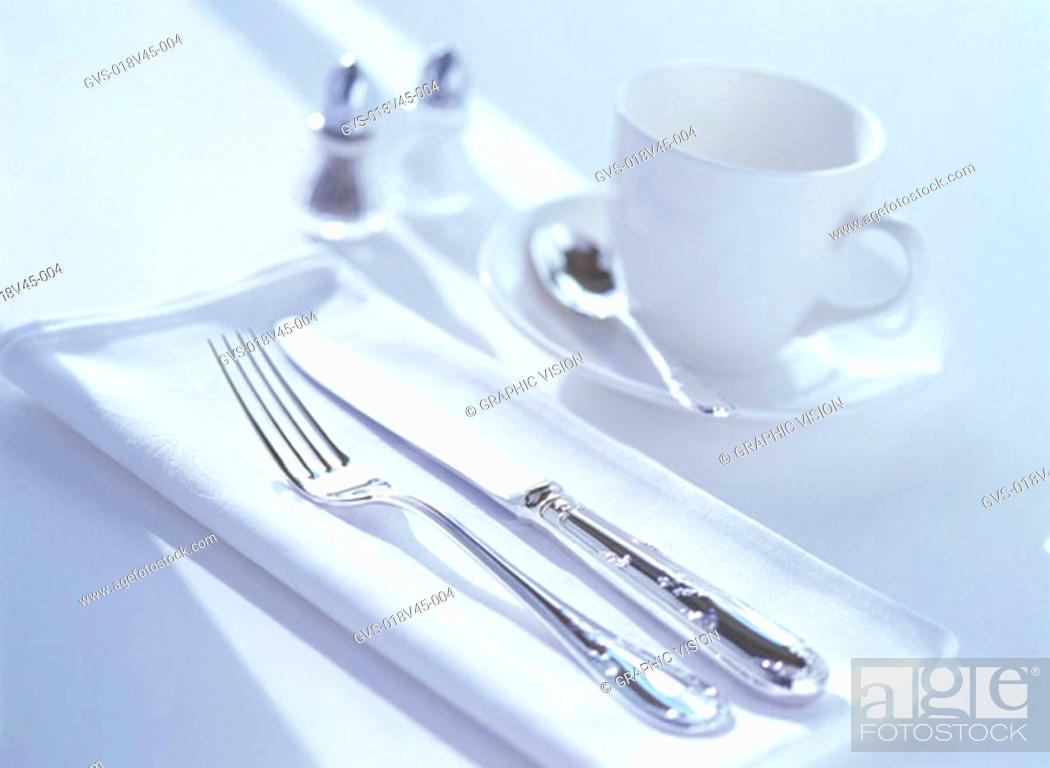 Stock Photo: Close Up of a Knife Fork and Tea Cup.