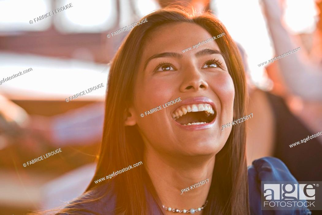 Stock Photo: Close-up of a woman laughing.
