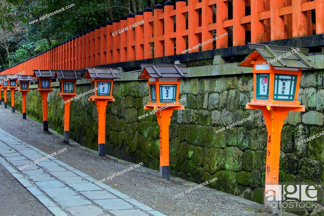 Stock Photo: An orange fence and temple lights behind Yasaka Shrine.