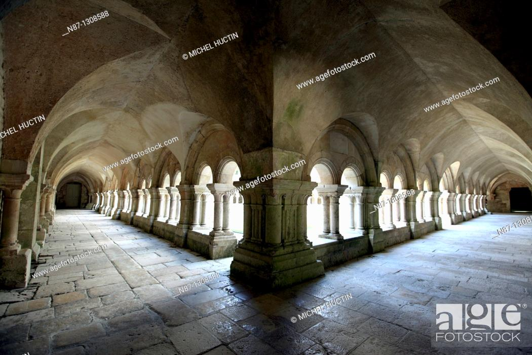 Stock Photo: the cloisters surrounding the courtyard of the monastery of the cistercian Abbey of Fontenay, Burgundy, France.