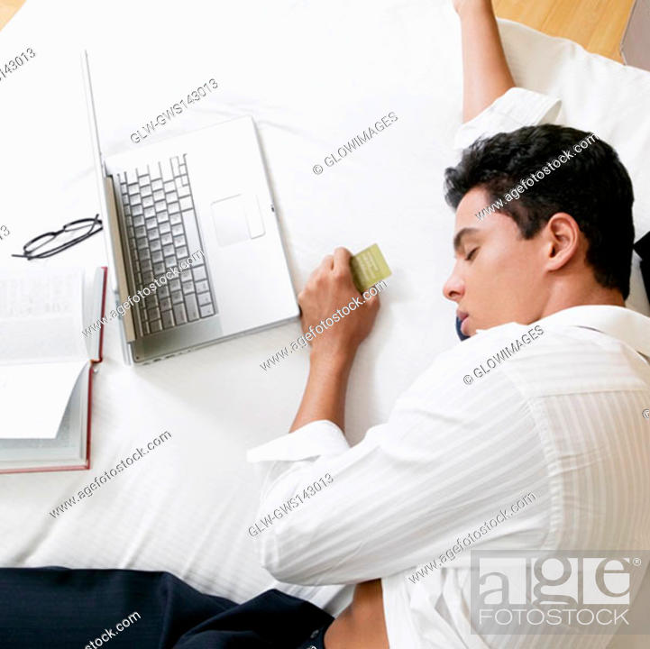 Stock Photo: High angle view of a businessman sleeping on the bed.