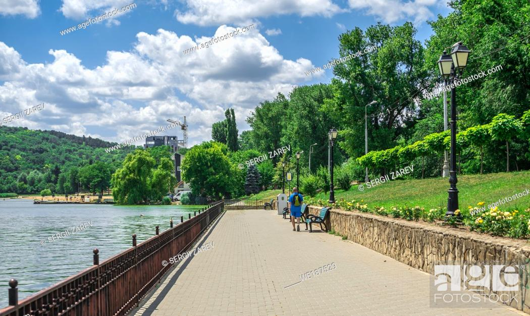 Stock Photo: Embankment of Valea Morilor Lake in Chisinau, Moldova, on a sunny summer day.