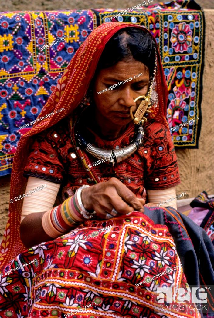 Stock Photo: Woman Busy with embroidery work.