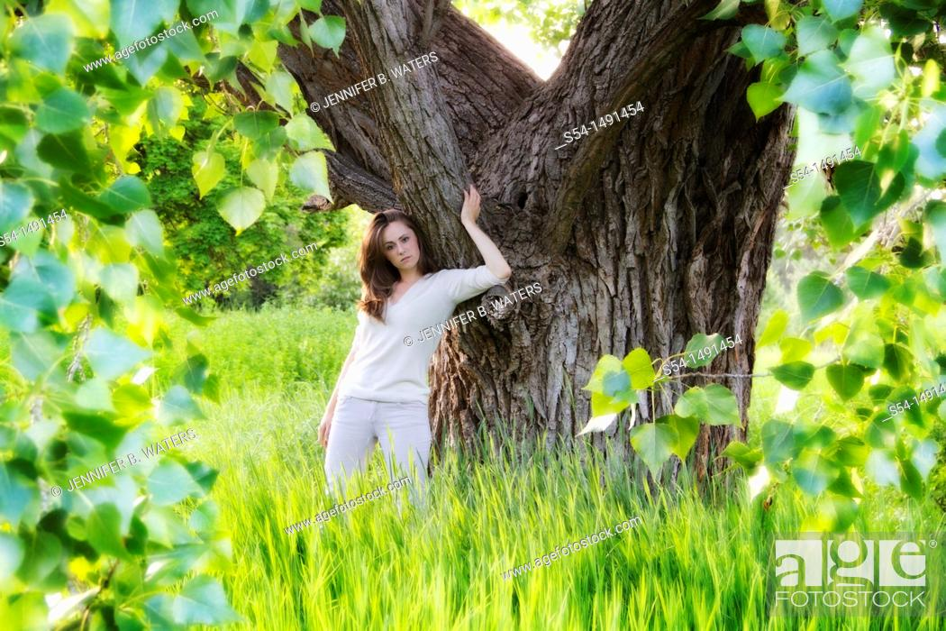 Stock Photo: A young woman outdoors in the summer in Spokane, Washington, USA.