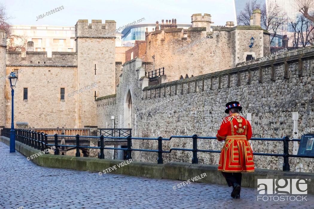 Stock Photo: England, London, Tower of London, Tower Walls and Beefeater.