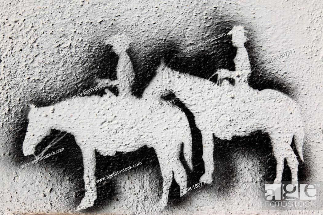 Stock Photo: cowboy western wall spray paint.