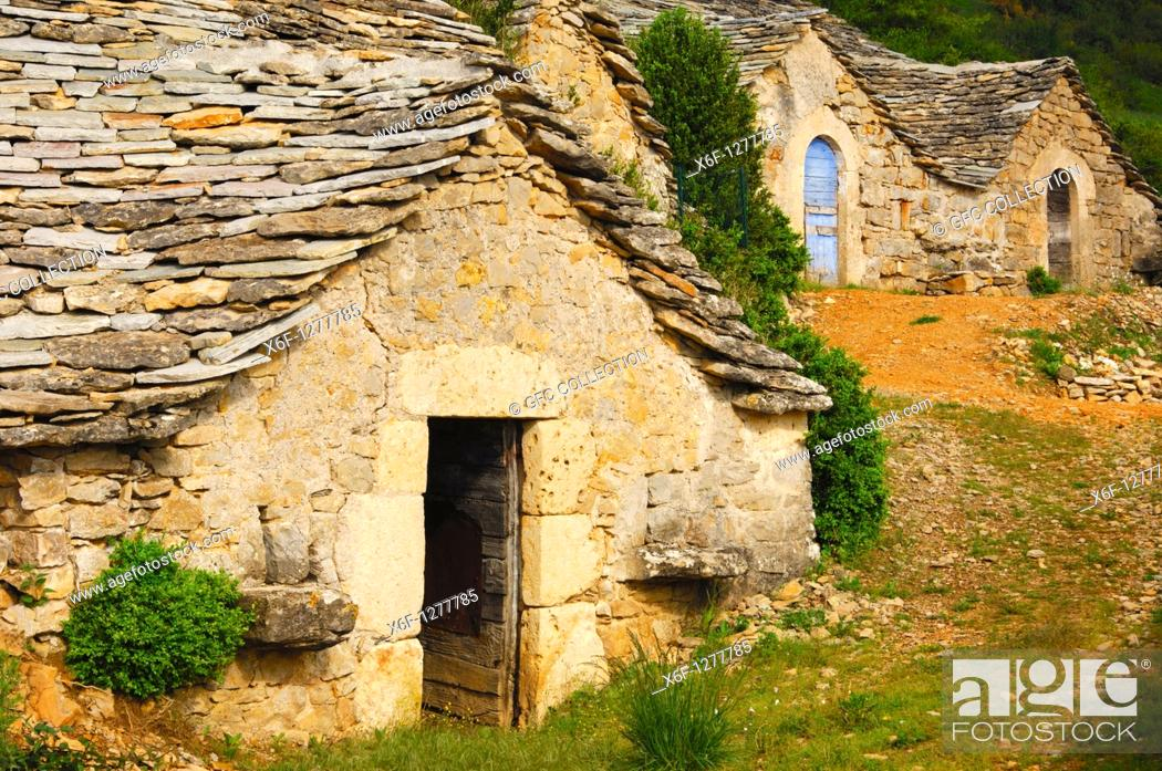 Stock Photo: Abandoned semitroglodyte wine cellars with a natural stone roof in Entre-deux-Monts near Riviere-sur-Tarn, Aveyron, France.