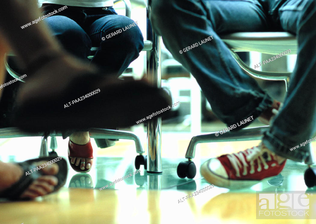 Stock Photo Legs And Feet View Under Table