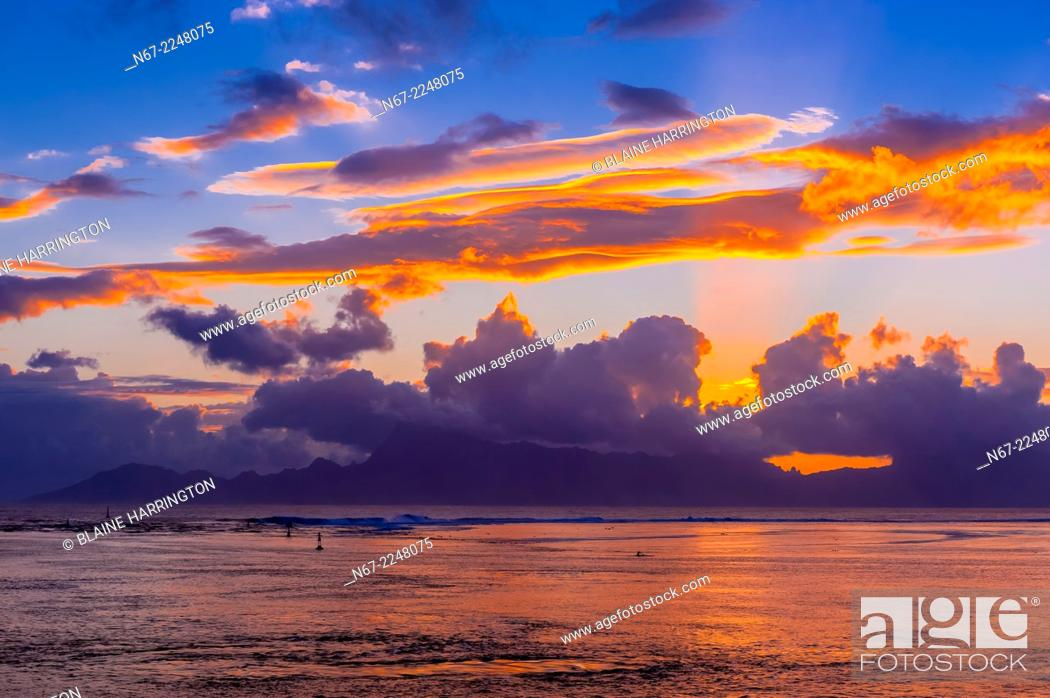 Stock Photo: Sunset over the island of Moorea, seen from Manava Suite Beach Resort, Punaauia, Tahiti, French Polynesia.