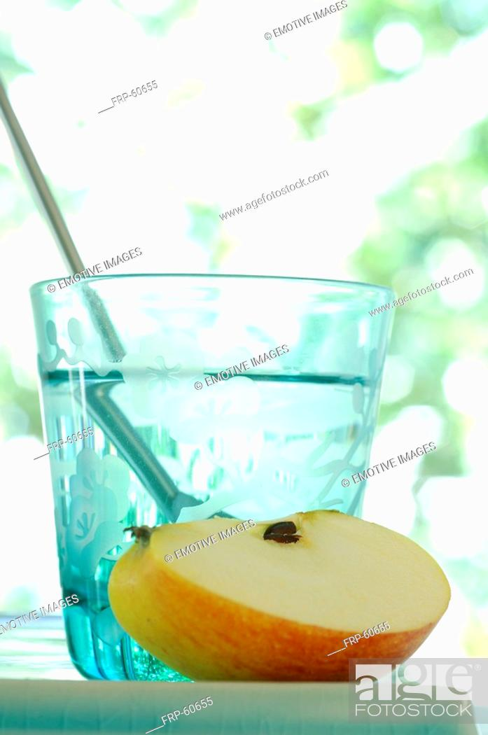 Stock Photo: Glass of water and a piece of apple.