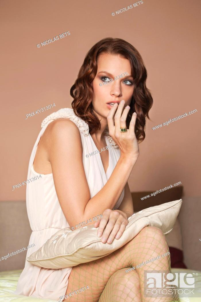 Stock Photo: Young woman looking worried.