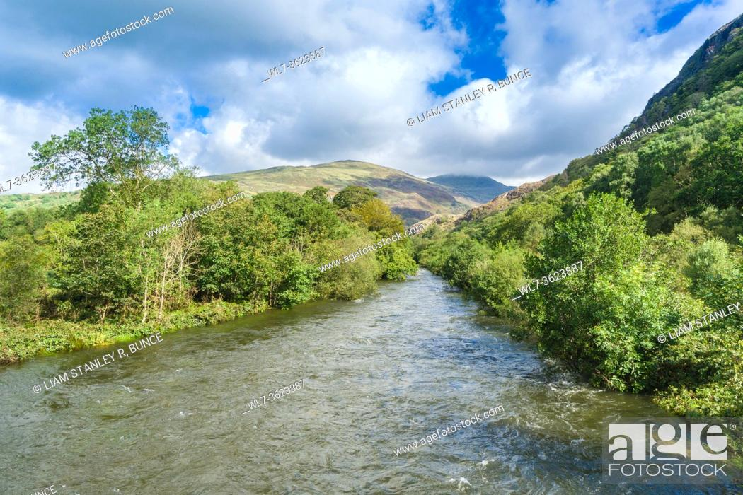 Stock Photo: River Glaslyn flowing towards Pont Aberglaslyn, Beddgelert North Wales UK. August 2020.