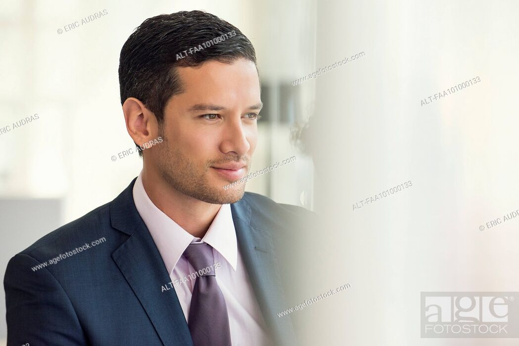 Stock Photo: Businessman looking away in thought.