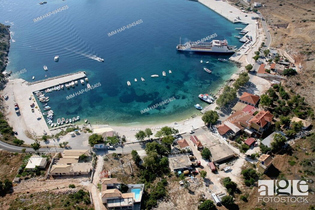 Stock Photo: Aerial view of Agios Nikolaos port. Boats leave daily for the famous blue caves near Cape Skinari. Zakynthos, Ionian Islands, Greece, Europe.