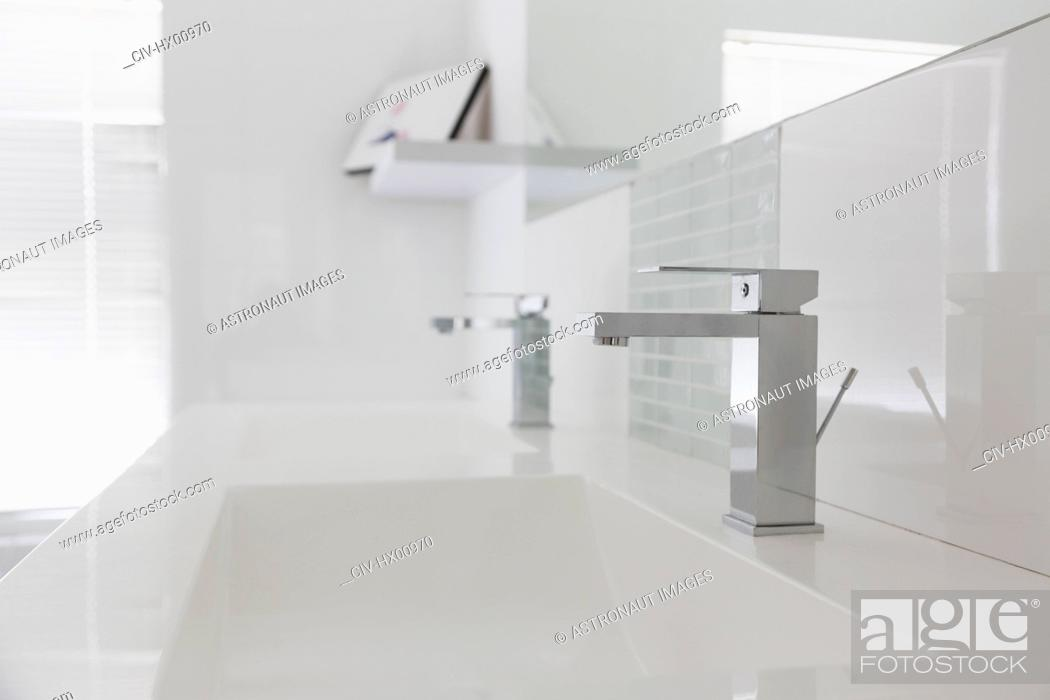 Stock Photo: Modern white bathroom sink and faucet in home showcase interior.