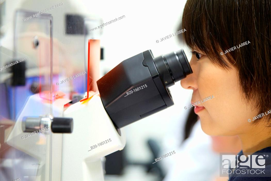 Stock Photo: Student. Inverted optical microscope. With incubator chamber for in vivo experiments. Advanced techniques such as TIRF, confocal, FRET.