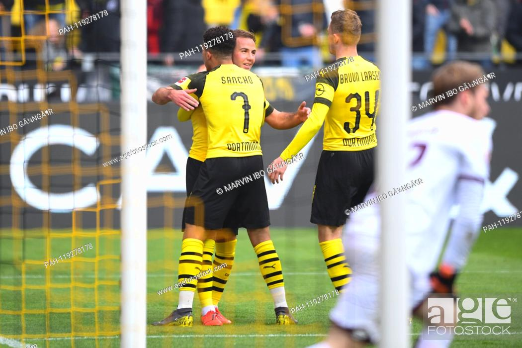 Stock Photo: jubilation over the 1: 0: left to right Mario Goetze (BVB), goalkeeper Jadon Sancho (BVB), Jacob Bruun Larsen (BVB). GES / Soccer / 1.