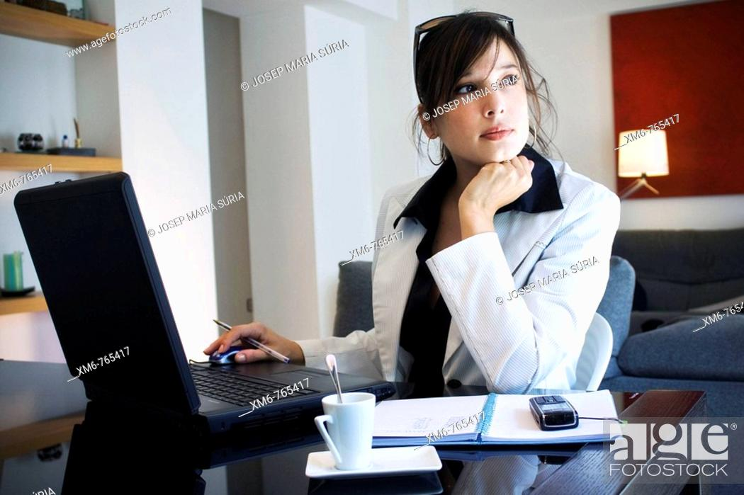 Stock Photo: Young executive meditating while working on her laptop.