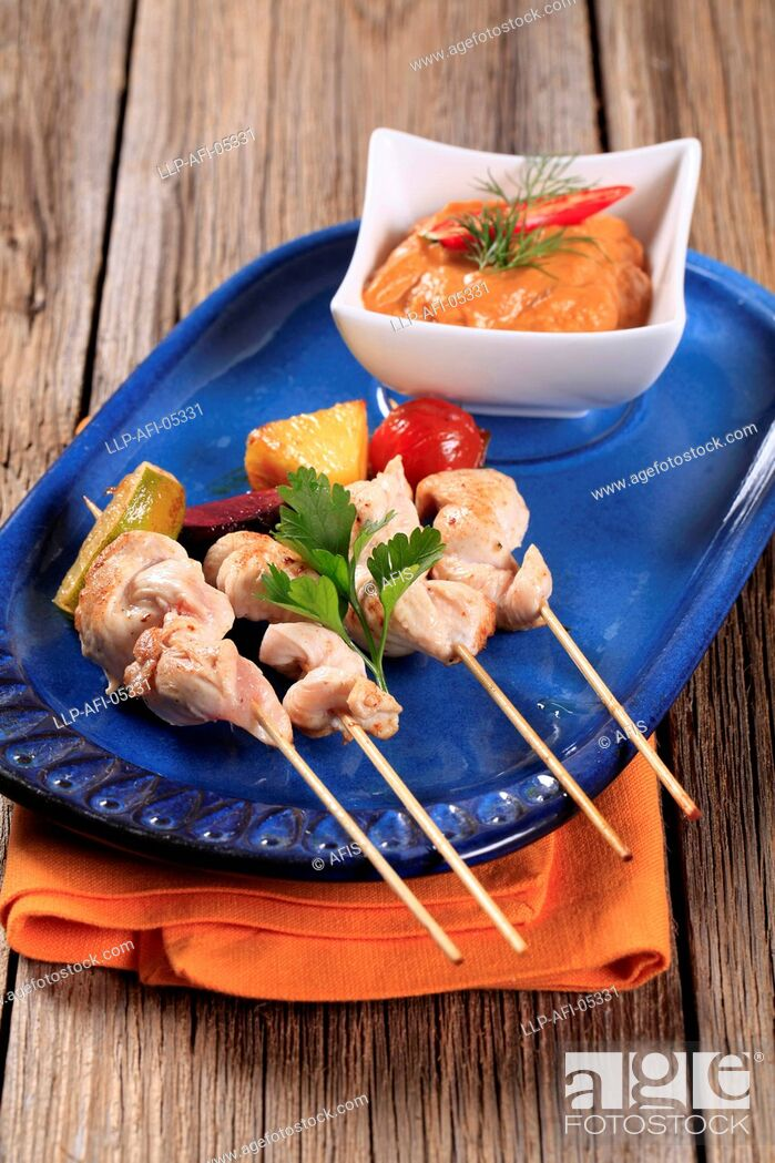 Stock Photo: Chicken skewers and Romesco sauce.
