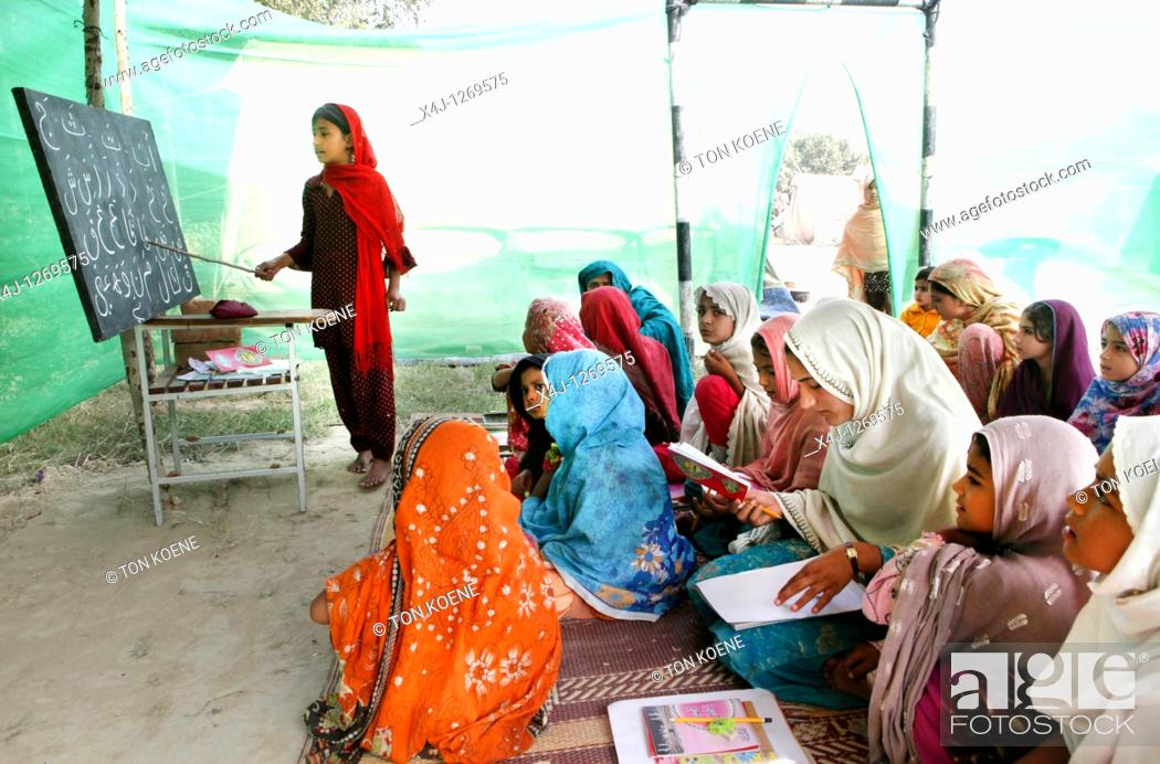 Stock Photo: pakistani learning the koran.