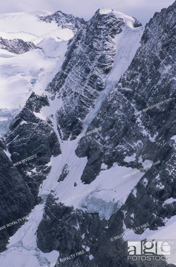 Stock Photo: Alpine lake with glacier and mountains surrounding, Lake of the Hanging Glacier, East Kootenays, B C.