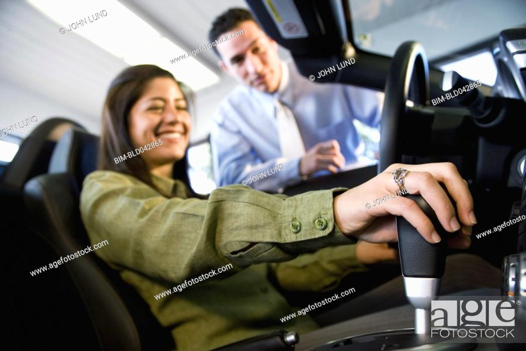 Stock Photo: Woman sitting in new car.
