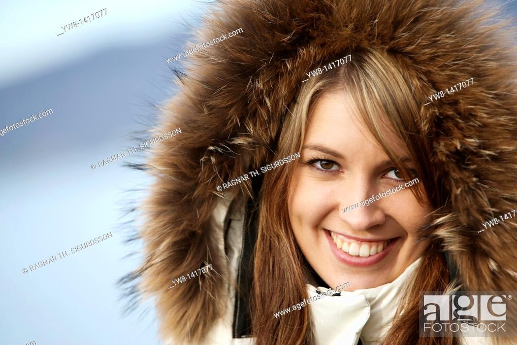 Stock Photo: Young woman wearing hood.