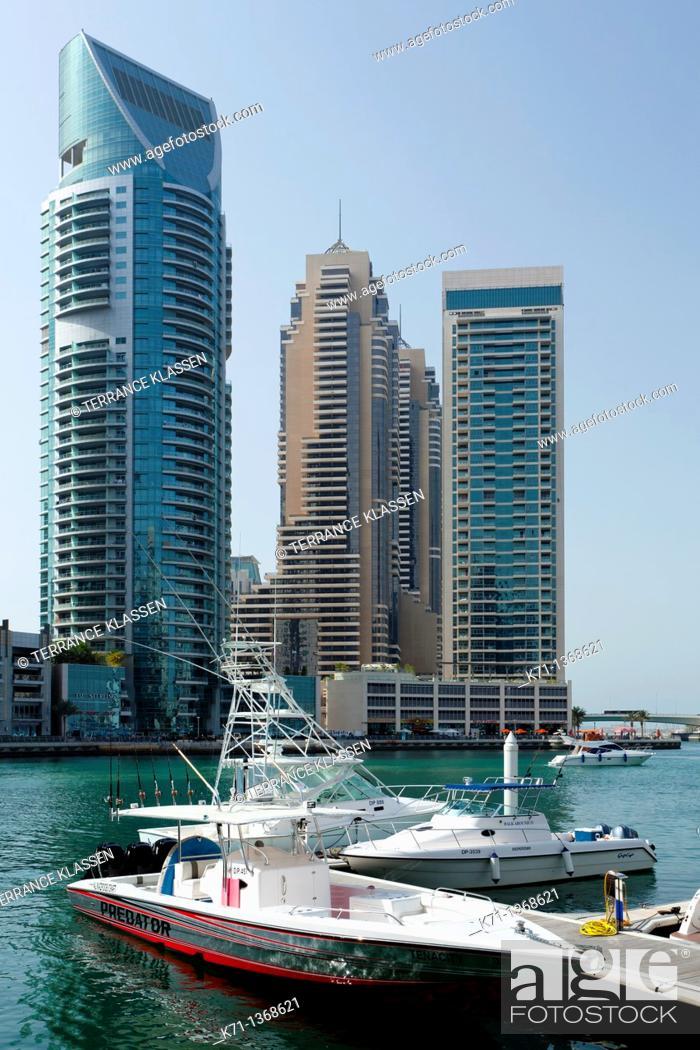Stock Photo: The Dubai Marina with high rise buildings and boats in Dubai, UAE, Persian Gulf.